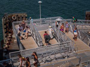 tourists walking on platform in cape cod_history of cape cod_cape cod history_cape cod tourism