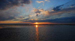 sun over water on beach at provincetown massachusetts_provincetown ma tourism_cape cod tourism