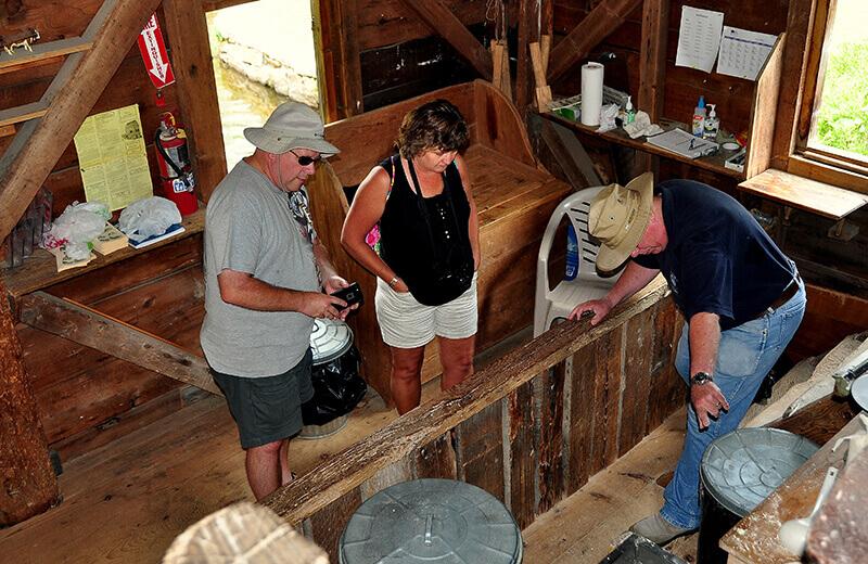 tourists at dexter grist mill in sandwich massachusetts