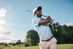 Golf on Cape Cod_man golfing on cape cod golf course