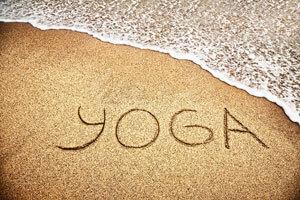 yoga written in sand on beach_wellness activities on cape cod_cape cod yoga