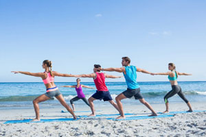 people doing yoga on the beach in cape cod_cape cod wellness_cape cod yoga_things to do on cape cod