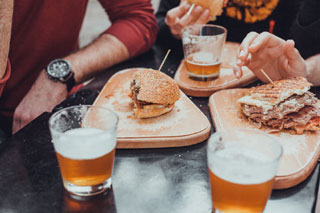 plates of food and glasses of beer at one of the breweries in cape cod_cape cod breweries