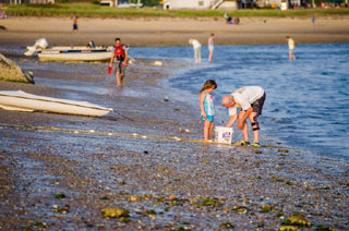 top best things to do in cape cod for seniors_older person and child on beach_retiring on cape cod