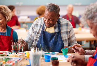 older person making art_the best activities for seniors on cape cod_retiring on cape cod