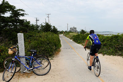 person on bike entering bike trail on cape cod_things to do on cape cod