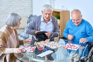 group of older people playing games at one of the retirement communities on cape cod_retiring on cape cod