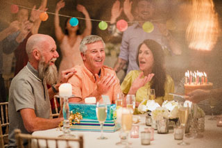 group of people celebrating a birthday at one of the retirement communities cape cod