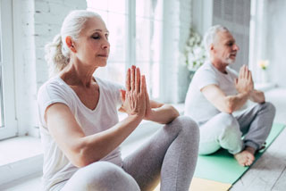 two people doing yoga at one of the retirement communities cape cod_retiring on cape cod