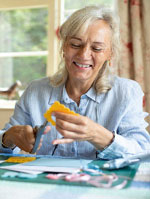 person doing crafts at one of the retirement communities cape cod_retiring on cape cod