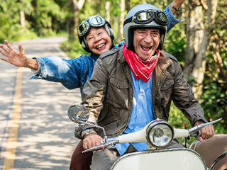 two people having fun riding mopeds_cape cod retirement communities