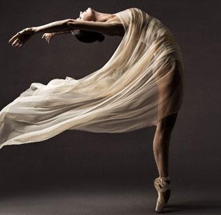 photo of person in a dancing pose_ballerina_volunteering in cape cod