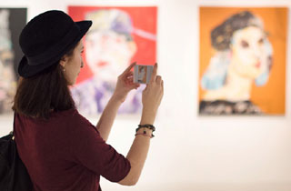 image of person taking a photo at an art museum_volunteering in cape cod