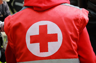person wearing a red cross jacket_volunteering on cape cod