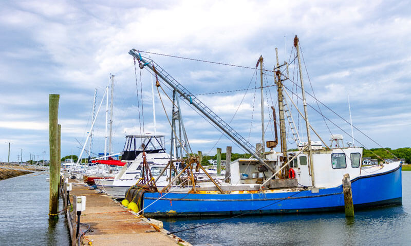 fishing boats on dock on cape cod_cape cod travel tips