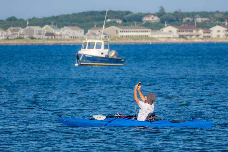 person kayaking near cape cod_cape cod travel guide_things to do on cape cod