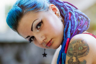 person with blue hair dreads and tattoos_cape cod thrift stores_shopping on cape cod