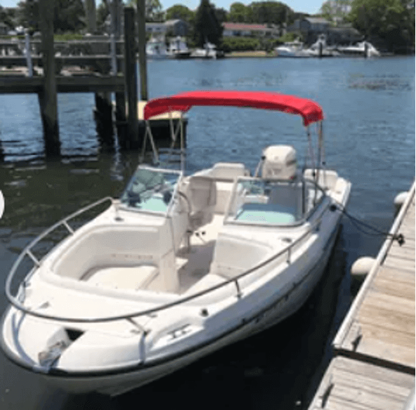 boat tied to dock_boat rentals on cape cod_things to do on cape cod
