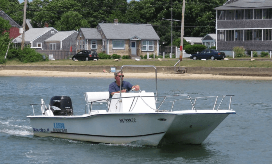 person driving boat_cape cod boat rentals