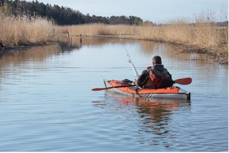 person fishing from kayak_kayaking in cape cod_fishing in cape cod