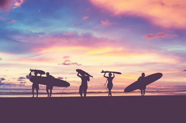 surfers on beach_ vacations at cape cod