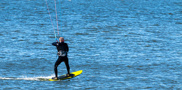 person parasailing on cape cod_cape cod fall vacation